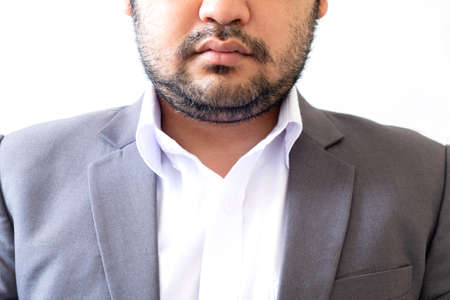 Close up of businessman in gray color suit with beard and mustache