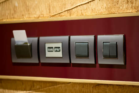 Close up of panel light switch and key card for electricity in hotel