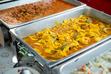 Variety of Thai food on tray in buffet at event