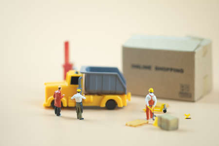 Miniature people : Worker team moving order from online shopping. Concepts of logistics and transportation
