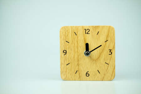 Table wooden clock square shape on front view. Close up