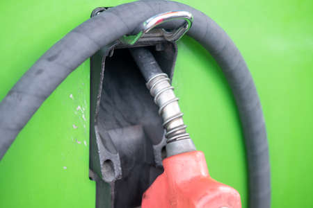 Detail of oil fuel filling nozzles at petrol pump. Close up on fuel nozzle in oil dispenser