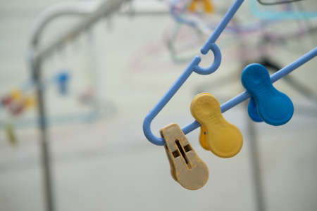 Old plastic clothespins on the hangers. Close up
