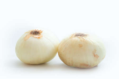 Two bulb onions isolated on a white background