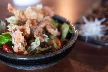 Soft shell crab salad in bowl. Close up
