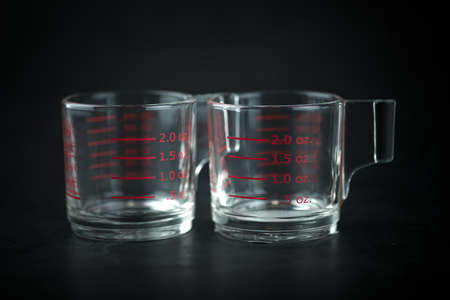 Volumetric measuring glass on a black background