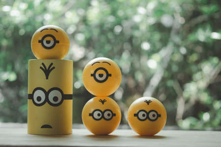 Bangkok, Thailand - July 2, 2020 : Yellow plastic capsule of Minions toy from McDonalds Happy Meal. Random toy in capsule Redakční