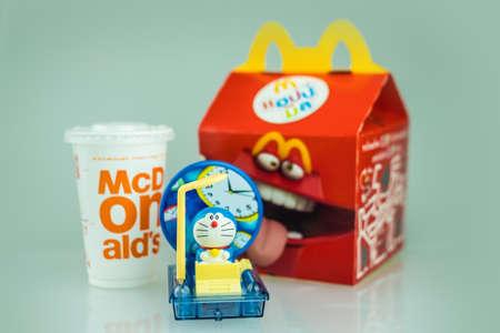 Samut Prakan, Thailand - August 30, 2020 : Toy plastic toy sold of the McDonald's Happy meals. Doraemon a blue robot cat a main protagonist of Doraemon Japanese animation cartoon.