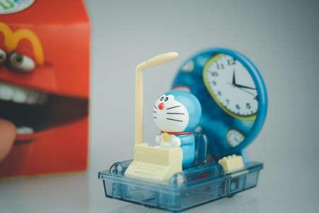 Samut Prakan, Thailand - September 9, 2020 : Toy plastic toy sold of the McDonald's Happy meals. Doraemon a blue robot cat a main protagonist of Doraemon Japanese animation cartoon.