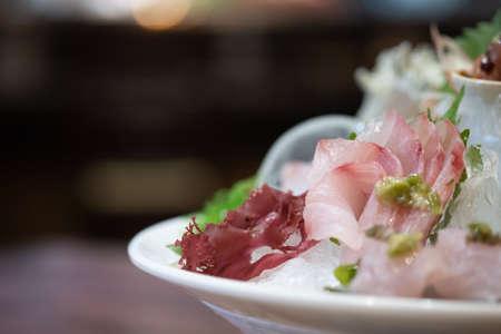 A set of Omakase fish sashimi premium set serve on ice. Japanese food style
