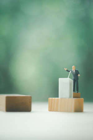 Miniature politician or party candidate in excited speech persuades to vote for him. Election debates or press conference concept Stock Photo