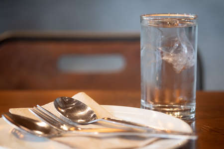 Cold drink with ice cubes on bar or restaurant. Selective focus