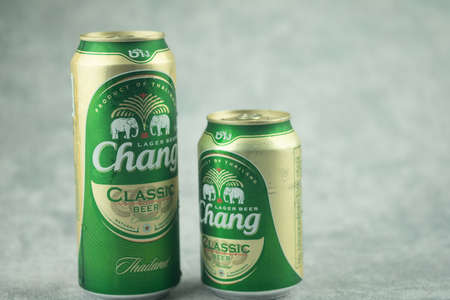 Bangkok, Thailand - November 30, 2020 : Two cans size of Chang beer, a pale lager brewed by ThaiBev, Thailand's largest and one of Southeast Asia`s largest beverage companies