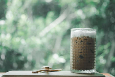 Ice coffee Mocha in a tall glass. Cold summer drink. Copy space for text