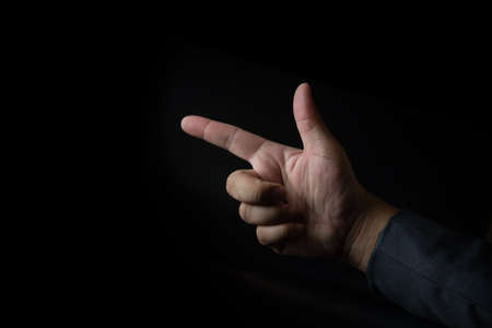 Closeup of businessman hand pointing. The hand gesticulates in left 写真素材