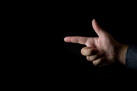 Businessman hand pointing, touching or pressing isolated on a black background