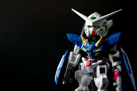 Samut Prakan, Thailand - February 18, 2021 : Gundam anime figure on a black background. Anime is a popular type of animation or cartoon in Japan.