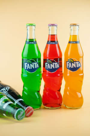 Samut Prakan, Thailand - March 8, 2021 : Popular soft drink in glass bottle volume 375 ML. such as Coca-Cola, Fanta of three flavour and Sprite on a orange background Editorial