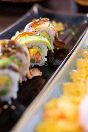 Sushi rolls avocado with cream, sesame, unagi sauce. Sushi menu. Japanese food.