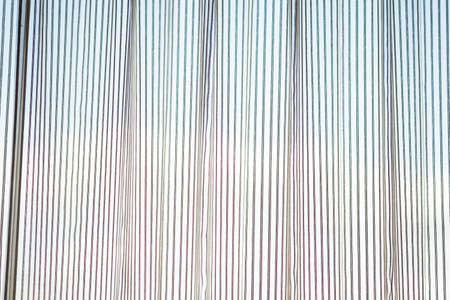 White transparent window curtains with sun shining