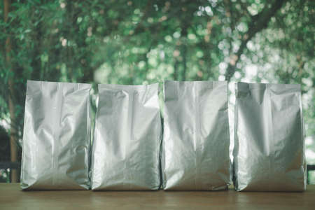 Front view of blank foil bag for tea, coffee and grain packaging. Retail shopping and advertising concept.