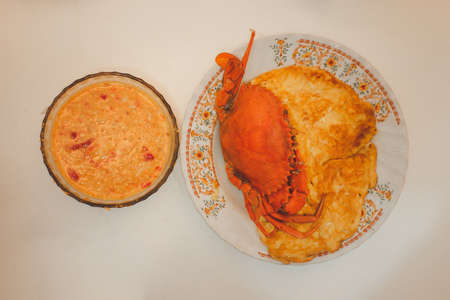 A big of steamed crabs placed on traditional Thai omelet served with seafood spicy sauce. Homemade food