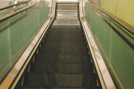 Escalator in a building. High angle view