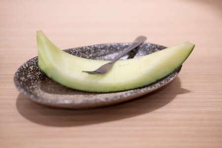 Peel sweet green melon Japan after eat at Japan restaurant