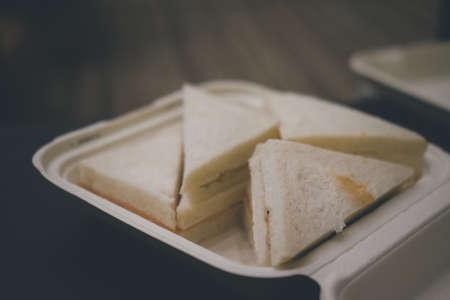 Ham triangle sandwich in box. Close up 免版税图像