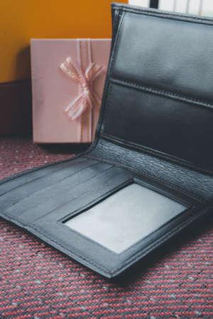 Genuine Brown Leather men's bifold wallet. Selective focus