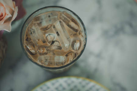 Cup of iced Mocha coffee on table, top view