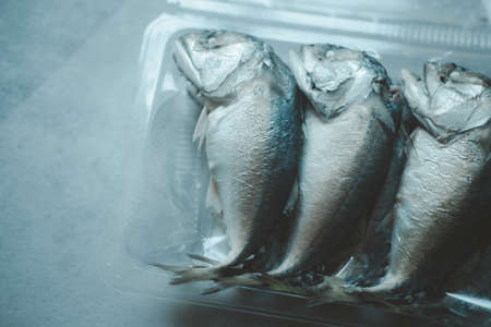 Pack of steamed mackerel in box. Top view