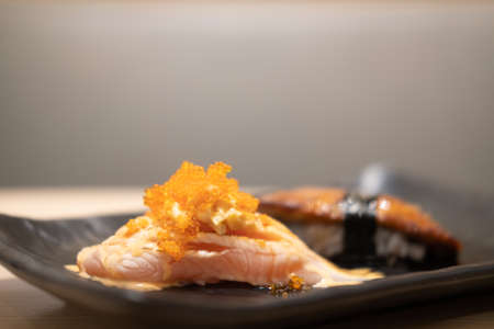 Salmon sushi decoration with roe on top. Traditional Japanese food 免版税图像