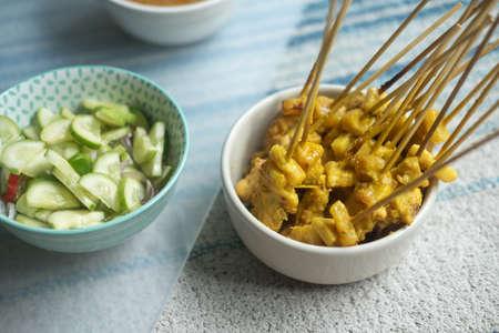 Pork Satay with cucumber, fresh chili, shallot. Thai food.