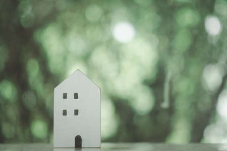 Mini wood house model from model on wood table in the nature background. Planning to buy property and Choose the best. 免版税图像