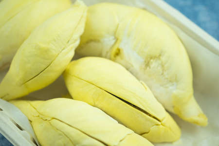 Durian that has been peeled ready to eat in box. The yellow flesh has a sweet and smell. Fruit in summer season.