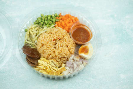Shrimp paste sauce fried rice with boiled salted egg and vegetables in box, Thai menu call Nam Prik Long Rua, Healthy Thai