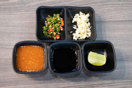 Set of chopped garlic and chili seasoning for topping sauce in shabu or sukiyaki hot pot