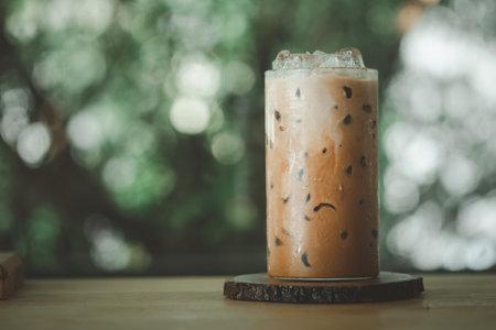 Ice Mocha coffee in glass on a wood table 免版税图像