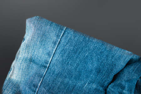 Fold jeans against black background. Top view 免版税图像