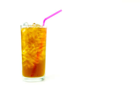 Glass of lemon iced tea with pink straw on white background