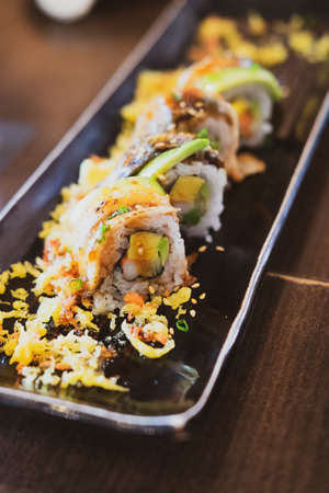 Sushi maki rolls on a tray. Japanese food, Mix colorful sushi Set of different kinds of sushi rolls