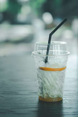 Empty glass with little left iced and sliced orange fruit at cafe