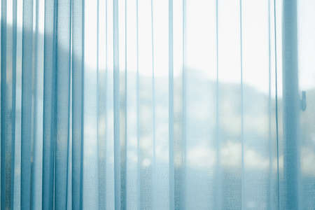 Airy or thin and transparent blue sheer curtain for see through and soft light on balcony window and close in room for home
