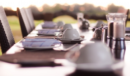 breakfast room: Restaurant table setting with coffee cup Stock Photo