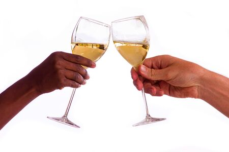 Two people toasting with glasses of white wine isolated on a white background