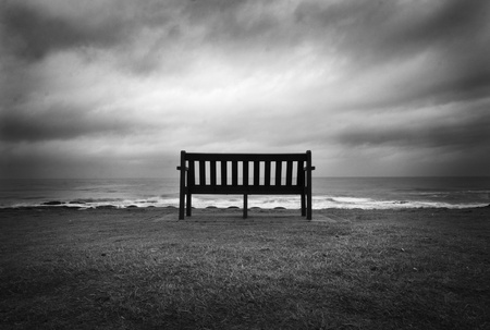 yorkshire and humber: Lonely Bench facing the ocean and dramatic sky