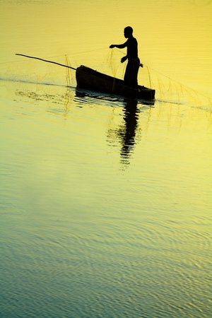poling: Dramatic sunset of a Traditional Fisherman Sillhouette