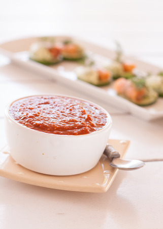 red chilly: Chili dipping sauce with snacks in the background