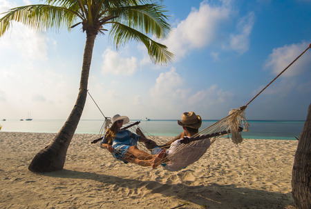 Relaxing time in Kuredu, Maldives on hammock with beach and sea in the background